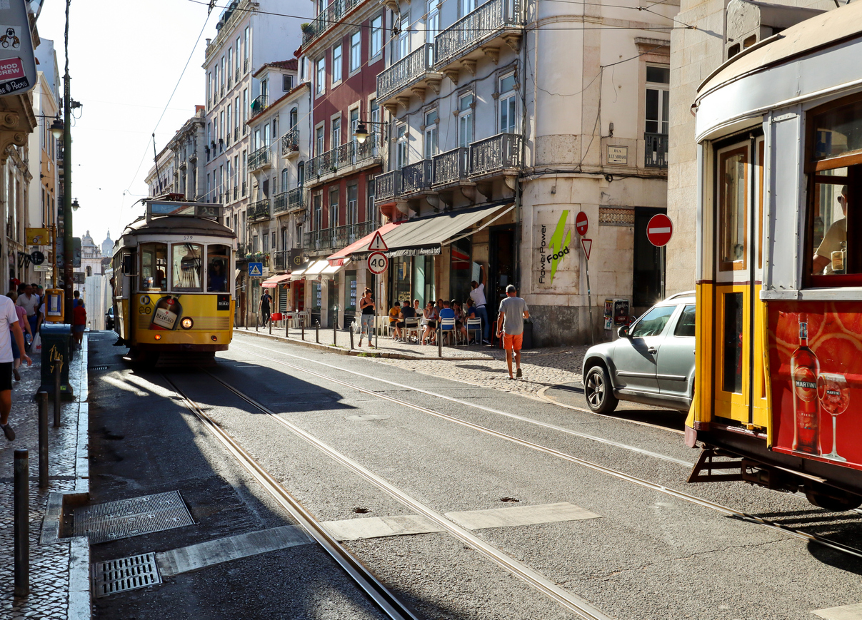 Busy lifestyle in the old town of Lisbon with traditional tram , shops and urban life in Bairro Alto district, Lisbon Portugal
